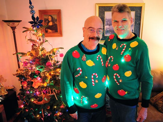 Ken Cook and Jeff Standy pose in the sweaters they wore at their ugly-sweater-themed wedding reception last weekend.