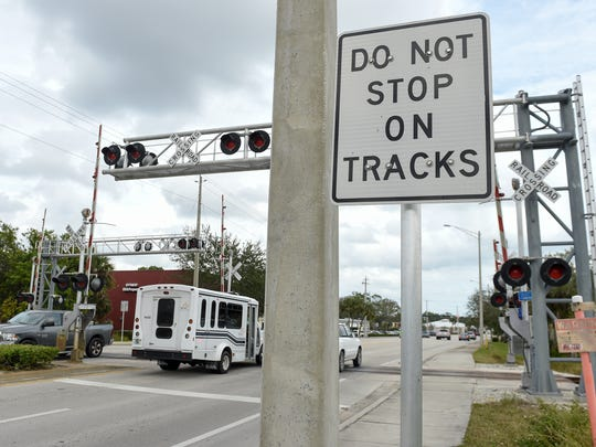 In this Jan. 23, 2018 photo, traffic crosses the Florida East Coast Railway train tracks along 17th Street in Vero Beach. Indian River County has filed a state lawsuit over whether the county should pay for crossing changes needed for Virgin Trains, formerly Brightline, to run its higher-speed passenger trains.