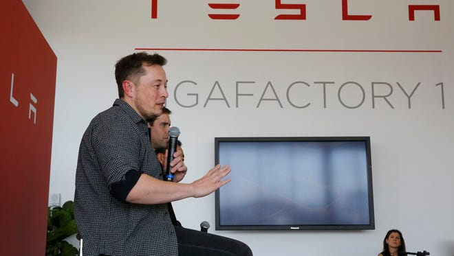 Elon Musk, CEO of Tesla Motors Inc., left, discusses the company's new Gigafactory Tuesday, July 26, 2016, east of Sparks.
