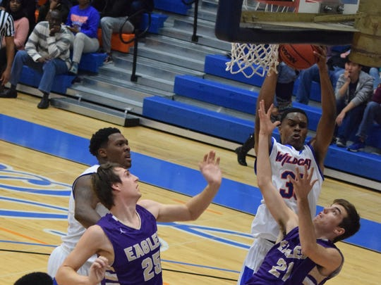 Louisiana College's Anthony Gaines Jr. (35, back right) gets the rebound against University of the Ozarks Ricky Scott (25, left) and Dillon Gash (21, right) Thursday.
