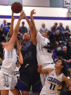 McQueen's Alisi Peaua (50) fights for a rebound while taking on Spanish Springs during their basketball game at Spanish Springs on Jan. 26, 2018.