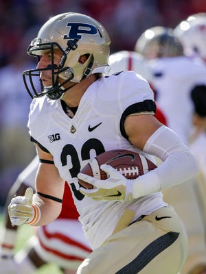 Purdue wide receiver Danny Anthrop (33) carries the ball in the first half of an NCAA college football game against Nebraska in Lincoln, Neb., Saturday, Nov. 1, 2014. (AP Photo/Nati Harnik)