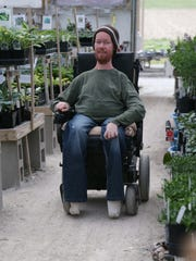 Josh Spece, of Independence, works at his greenhouse