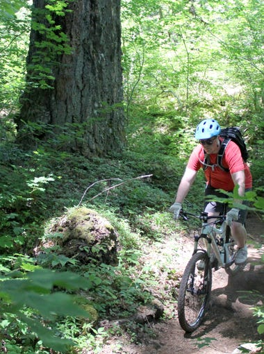 David Davis rides through the forest and lava fields of the McKenzie River Trail east of Eugene.