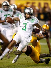 Oregon quarterback Vernon Adams Jr. eludes the Arizona State defense during a Pac-12 game on Oct. 29, 2015, in Tempe.