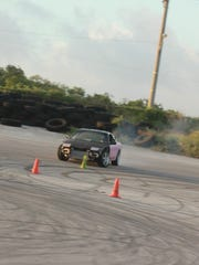 Shane Bruce smokes out his tires Sunday in the final round of the 2015 Proline Drifting Championships held at the Guam International Raceway in Yigo.
