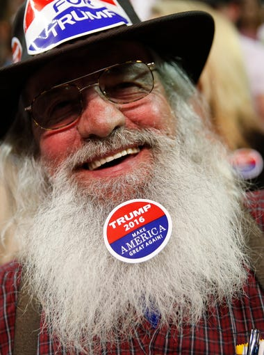 A Donald Trump supporter wears a sticker on his beard at Valdosta State University Complex during his rally on Monday, Feb. 29, 2016.