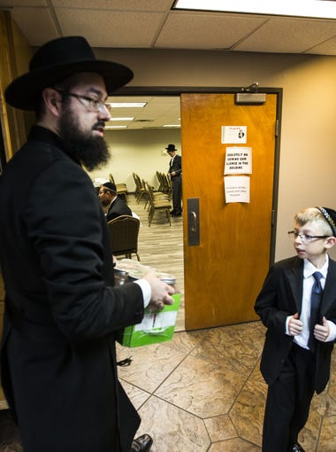 Yehoshua Bedrick heads into an afternoon prayer service before Passover at Chabad of Scottsdale on April 22, 2016 in Scottsdale, Ariz.