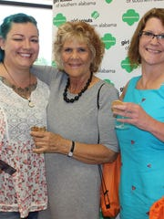 From left, Kelsea Jones, Char Jones and Dana Coker, enjoyed specialty cocktails inspired by Girl Scout cookies at Manicures, Massages and Merriment, hosted at Virginia College as a benefit for Girl Scouts of Southern Alabama.