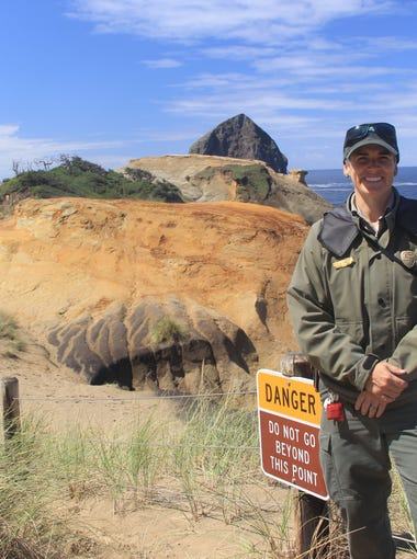 Lisa Stevenson is a park ranger for the Oregon Parks and Recreation Department who educates the public about the dangers of walking beyond the fence at Cape Kiwanda.