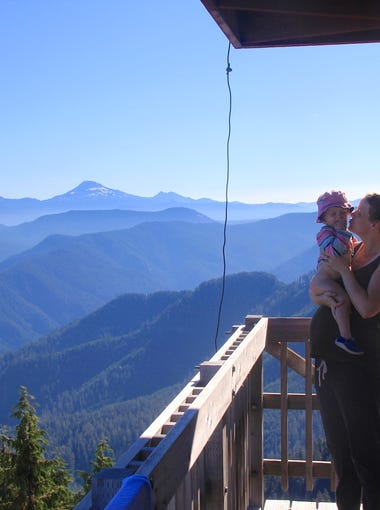 Robyn Orr and Lucy Urness take in the views from the deck at Indian Ridge Lookout.