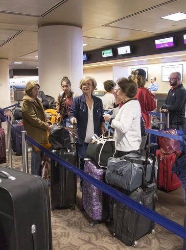 Passengers wait in line at Phoenix Sky Harbor International Airport for Thanksgiving travel on Monday, Nov. 21, 2016.