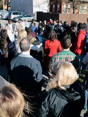 Dozens of mourners gather during an April 7 vigil for Jamie Urton, who was shot and killed in the Walnut Hills neighborhood of Cincinnati.