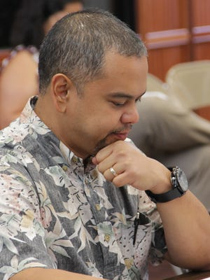 During a Committee on Rules meeting on July 5, Sen. Dennis Rodriguez Jr., D-Dededo, looks over the legislative resolution that named him the chairman of the Committee on Legislative Operations.