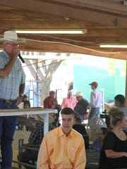 Auctioneers at the Eddy County Fair Junior Livestock Auction try to raise the bids for the champion sheep Saturday.