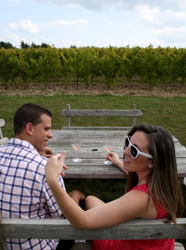 Gregg and Jamie Snyder from New Jersey, enjoy a glass of wine after a tasting at Hermann J. Wiemer winery on Seneca Lake.