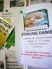 Flyer in an Alta Vista convenience store, shown Tuesday, Oct. 31, 2017, in Alta Vista, Iowa, in memorial of the death of an infant in August and arrest of the parents. Cheyanne Renae Harris, 20, and Zachary Paul Koehn, 28, were arrested on charges of first-degree murder and child endangerment in connection with the death of their son, Sterling Daniel Koehn.