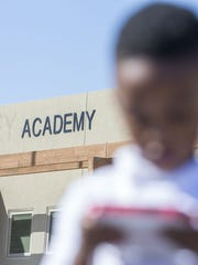 A preschool student stands outside Discovery Creemos Academy in Goodyear after its sudden closure in 2018.