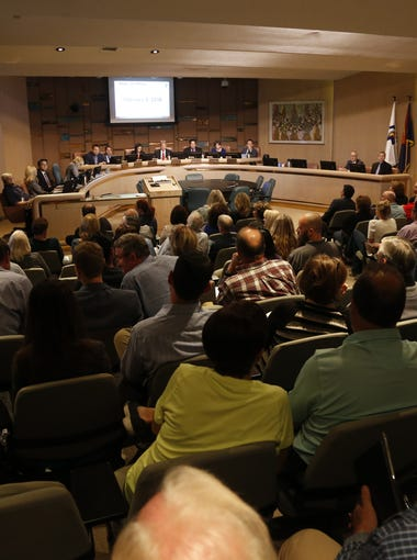 People gather at the City Council meeting at the Municipal Building on Feb. 8, 2018, in Tempe.