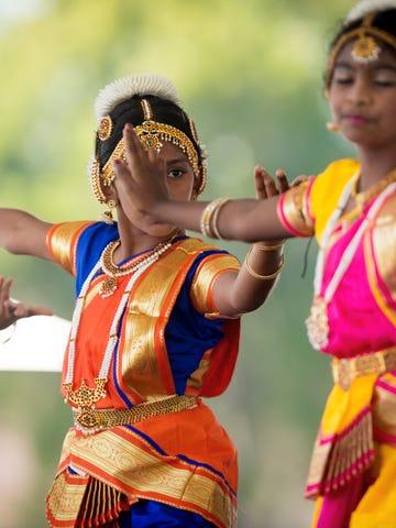 Sandra Jose, center, 10, dances a traditional Diwali