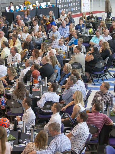 A crowd listens to a panel discussion during The Positive Coaching Alliance‐Arizona at Talking Stick Resort Arena on Monday, June 11, 2018.