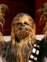 """The costume of the Wookiee Chewbacca,  made of yak hair and mohair, is part of the traveling exhibition """"Rebel, Jedi, Princess, Queen: Star Wars and the Power of Costume,"""" which opened Jan. 31 in Seattle's EMP Museum. The exhibit will remain up until October, but organizers have not revealed where it will go next."""
