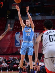 Tyler Lydon takes a jumper while playing for the Denver