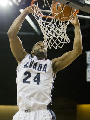 Nevada Wolf Pack's Deonte Burton goes up for a two-handed dunk against the Iona Gaels during their basketball game played on Sunday afternoon, December 22, 2013 at Lawlor Events Center.