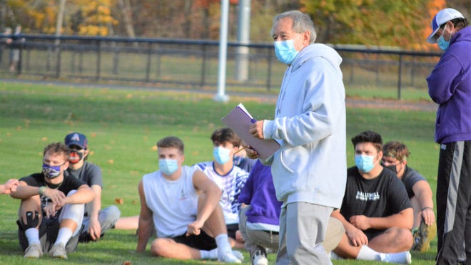 """Marshwood High School head football coach Alex Rotsko talks to his team during a break in practice on Monday. Marshwood and the 12 other high schools in York County were allowed to hold their first practices of the season as the county was shifted from a """"yellow"""" classification to """"green"""" last Friday."""