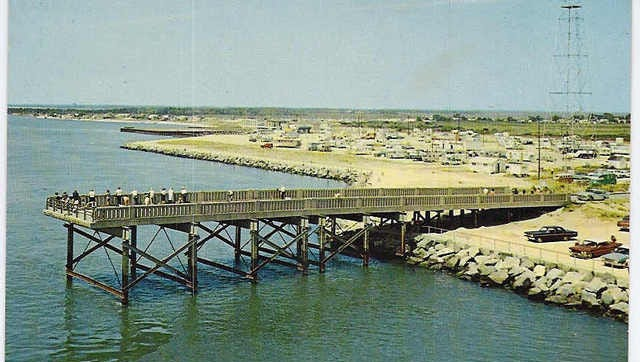 This vintage photo provided by Delaware Seashore State Park shows the old fishing pier on the north side of the Indian River Inlet, sometime in the 1960s.