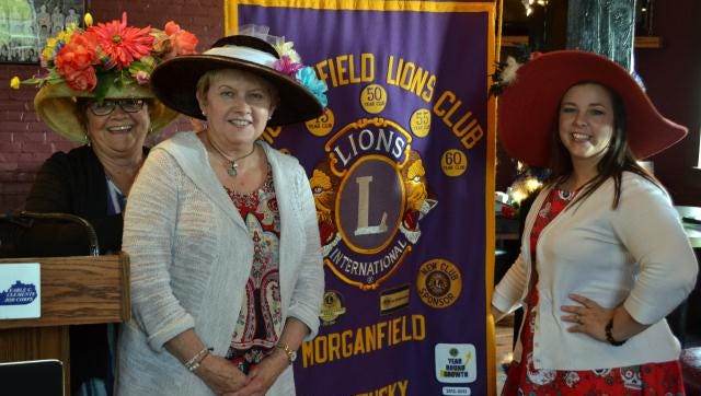 Sporting their best Kentucky Derby hats, at the May 5 Morganfield Lions Club meeting are, from the left, Old National Bank employees Marsha Lovern, Rita Mills and Kayla Graham.