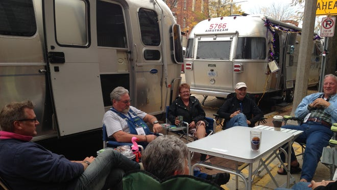 """Michael Creighton of Prince Edward Island, Canada (far left) visits with other """"Urban Air"""" campers on Main Street in Eaton Rapids on Thursday, Oct. 2."""