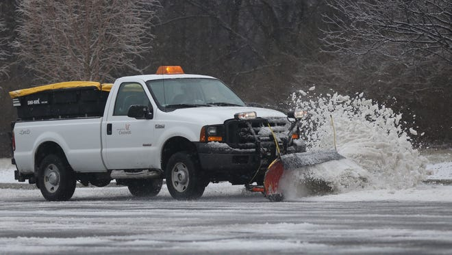 Snow removal at University of Cincinnati Blue Ash. Many schools were on delay Wednesday/