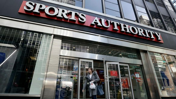 A woman leaves a Sports Authority store, in New York, Wednesday, March 2, 2016.