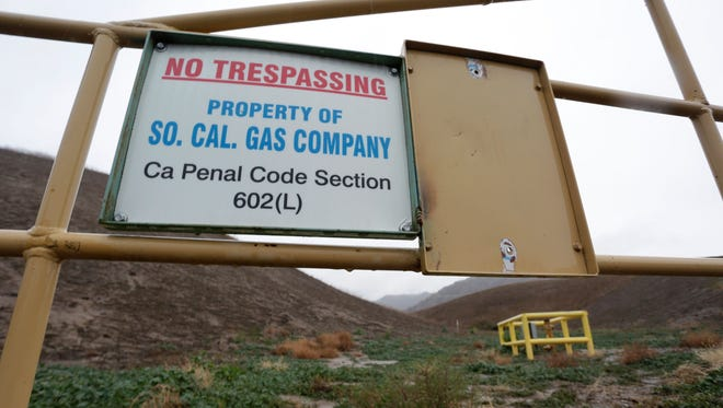 A sign marking the boundary of the Aliso Canyon storage facility is pictured in Porter Ranch, California, January 6, 2016.