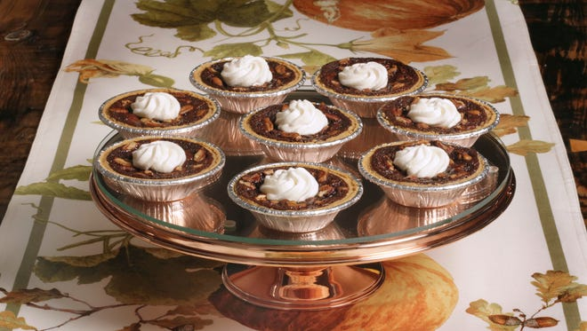 This Sept. 30, 2016 photo shows mini chocolate pecan pies at the Institute of Culinary Education in New York. This dish is from a recipe by Elizabeth Karmel.