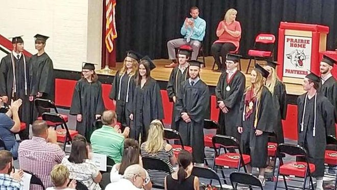 The Prairie Home High School Class of 2020 face their parents June 7 after the completion of commencement exercises.