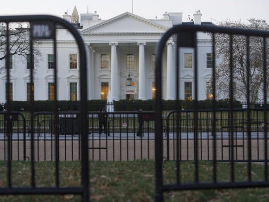 The White House behind security barriers in Washington.