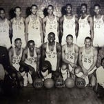 GO cover on the The Indianapolis Public School Crispus Attucks Museum...Pictured here, a lrage team photo of the famous 1955 Boy,s State Basketball Champs is on proud display in the Crispus Attucks Basketball Hall of Fame portion of the overall school museum. This team was the first all Black high school team to win a state championship in the entire country. The Crispus Attucks Museum