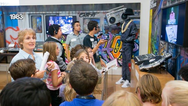Children on a field trip learn about Hip Hop at the Musical Instrument Museum in Scottsdale on Friday, April 17, 2015.