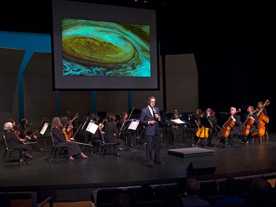 Dean Regas, astronomer for the Cincinnati Observatory brought NASA images to the Chamber Orchestra for a concert on a celestial theme.