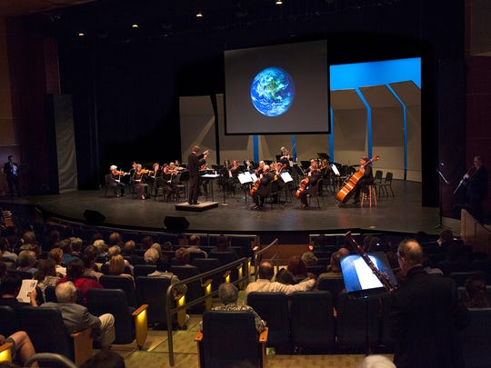 "Cincinnati Chamber Orchestra music director Eckart Preu placed individual musicians in various locations around the theater as part of the group's ""Celestial Voyage"" concert in August 2017."