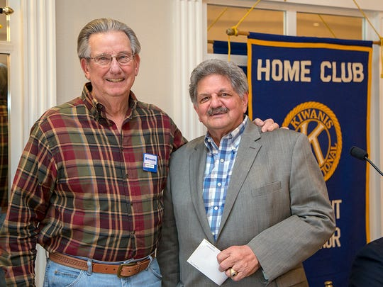 Don Paige (left), of the Kiwanis Club of Abilene, presents a donation to Joe Spano, of the Dyess Memorial Park Expansion Committee.