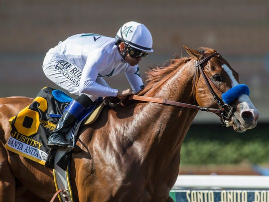 In a photo provided by Benoit Photo, Justify and Mike