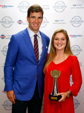 Field Hockey Player of the Year Jessica Welch from Shore Regional poses with NY Giants quarterback Eli Manning during the Jersey Shore Sports Awards dinner at Monmouth University Monday, June 13, 2016.