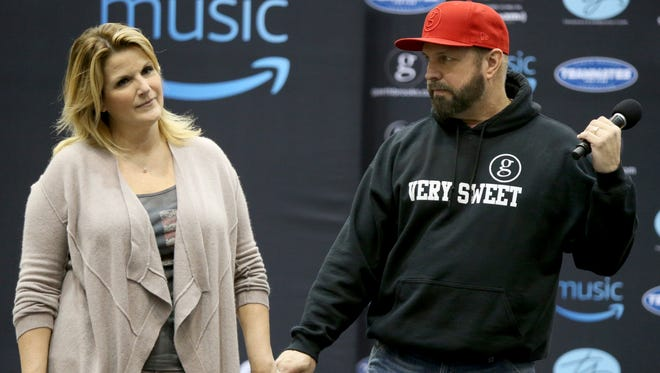 Trisha Yearwood and Garth Brooks take questions from the media before their sound check during a news conference at FedExForum.