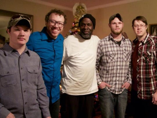 """Kenneth McCalister enjoyed Christmas Eve dinner in the Jackson home of Ted and Naomi Beck last year. They attend Thrive Church, where McCalister was a member. He was considered """"an honorary brother"""" in the Beck household. He is shown here with Jeremy, left, Josh, Trevor and Michael Beck."""