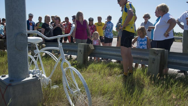 Bruce Henderson, president of Bike Fort Collins, says a few words regarding the incident on Kechter Road above Interstate 25, the site where 59-year-old cyclist Steve Studt was fatally injured June 26 after being run over by a dump truck. Members of the cycling community placed a ghost bike in his memory and to alert drivers to the presence of cyclists on area roads.