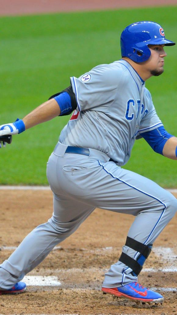 Cubs designated hitter Kyle Schwarber hits an RBI single