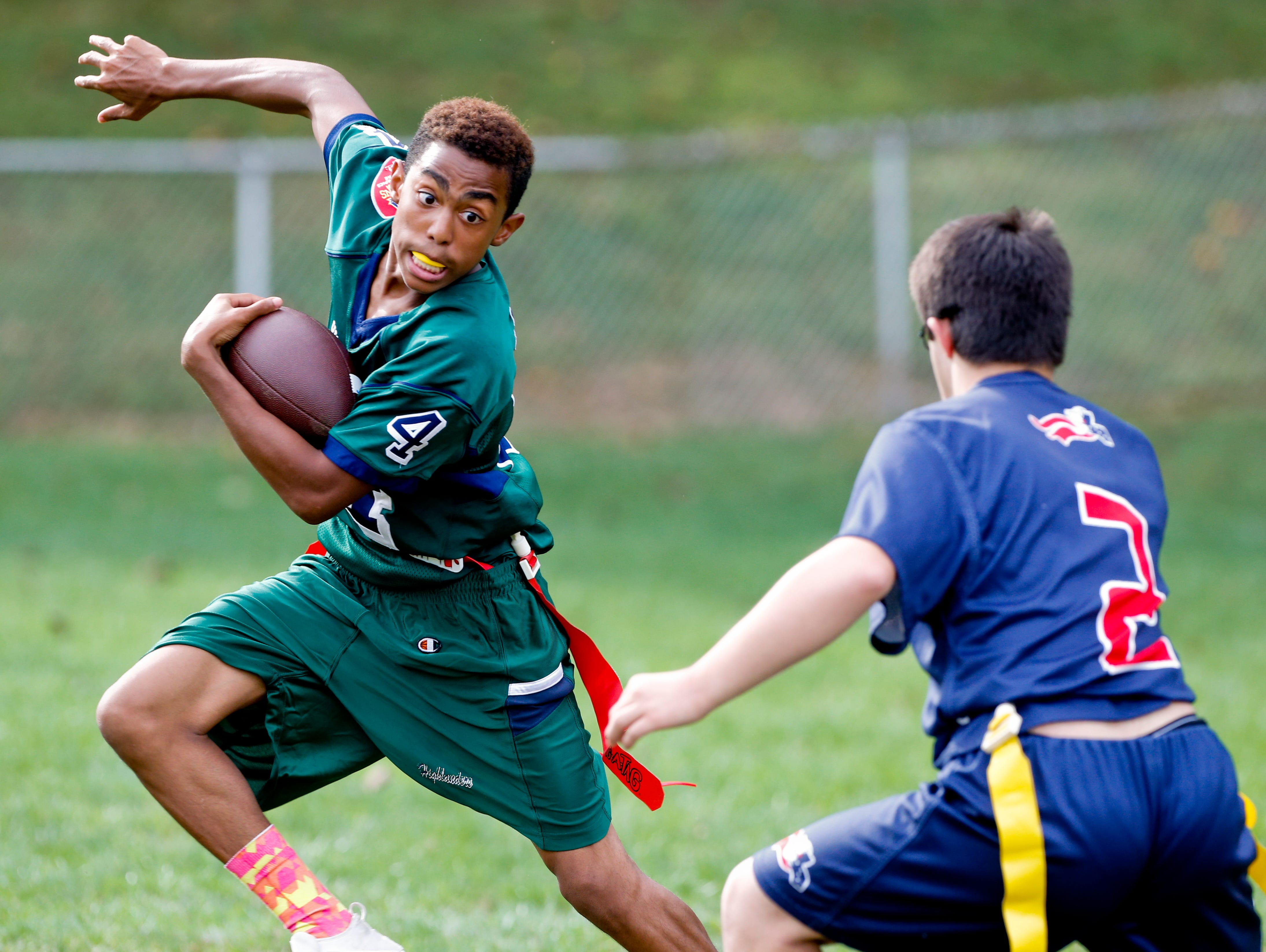 McKean's Otis Ledbetter tries to avoid a tackle by Newark Charter's Donovan Schwartz in an opening game of the Unified flag football season at McKean High School Tuesday.